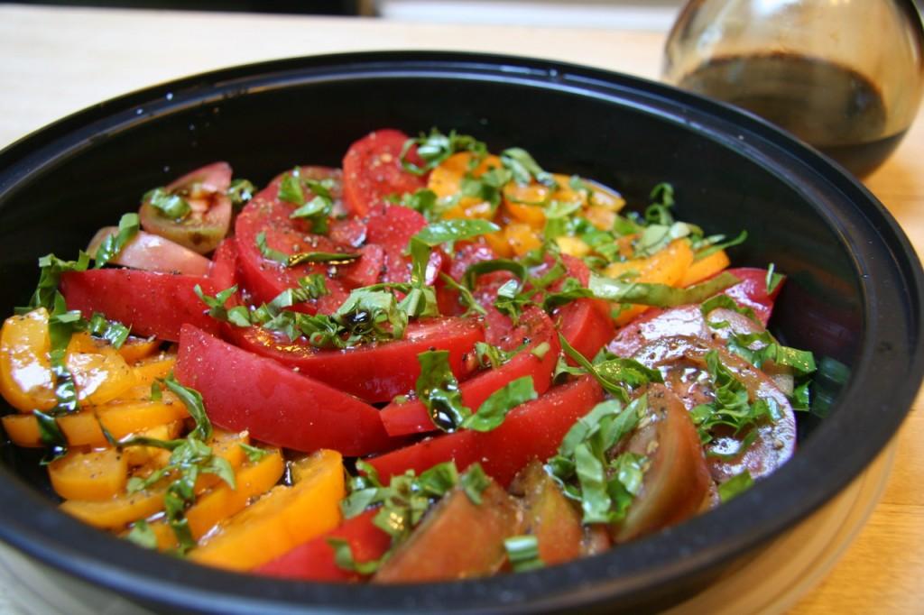 Tomatoes sliced, basil chiffonade...